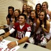 Sooner cheer squad members pose with quarterback Blake Bell during fan appreciation day for the University of Oklahoma Sooner (OU) football team at Gaylord Family-Oklahoma Memorial Stadium in Norman, Okla., on Saturday, Aug. 3, 2013. Photo by Steve Sisney, The Oklahoman