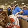 Matt Finney, with the Chesapeake H.E.L.P. Initiative, volunteers at the Regional Food Bank in Oklahoma City, OK, Saturday, June 6, 2009. By Paul Hellstern, The Oklahoman