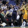 A referee, left, is knocked over as Charlotte Bobcats small forward Michael Kidd-Gilchrist (14) scuffles with members of the New Orleans Hornets during the first half of an NBA basketball game in New Orleans, Friday, Nov. 9, 2012. (AP Photo/Gerald Herbert)