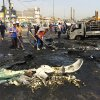 Photo - Baghdad municipality workers clean the site of a car bomb explosion in a commercial area of New Baghdad, Iraq, Tuesday, Aug. 26, 2014. The parked car bomb exploded on Tuesday in a busy area in eastern Baghdad, killing and wounding scores of people, officials said, the latest in a series of attacks to shake the Iraqi capital as the Shiite-led government struggles to dislodge Sunni militants from areas in the country's west and north. (AP Photo/ Khalid Mohammed)
