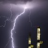 Lightning strikes as storms roll through the El Reno area Wednesday night. Two oil rigs stand in the foreground at the Cactus Oil Equipment comapny on Route 66 between Yukon and El Reno.