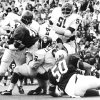 11/22/73. University of Oklahoma lineman Lucious Selmon makes a stop against Texas during the Sooners 52-13 win over the Longhorns in the Cotton Bowl in Dallas. Brother Dewey Selmon is No. 91. Staff photo taken 10/13/73.