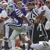Kansas State Wildcats\' Nigel Malone (24) runs an interception back past Oklahoma Sooners\' Trey Franks (2) during the college football game between the University of Oklahoma Sooners (OU) and the Kansas State University Wildcats (KSU) at Bill Snyder Family Stadium on Saturday, Oct. 29, 2011. in Manhattan, Kan. Photo by Chris Landsberger, The Oklahoman ORG XMIT: KOD