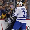 Pittsburgh Penguins center Evgeni Malkin (71) is pinned against the boards by Toronto Maple Leafs defenseman Dion Phaneuf (3) during the second period of an NHL hockey game in Pittsburgh, Wednesday, Jan. 23, 2013. (AP Photo/Gene J. Puskar)