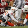 Oklahoma State\'s Zac Robinson (11) and Dantrell Savage (22) go after a fumble as Oklahoma\'s Lewis Baker (16) pursues on the play during the first half of the college football game between the University of Oklahoma Sooners (OU) and the Oklahoma State University Cowboys (OSU) at the Gaylord Family-Memorial Stadium on Saturday, Nov. 24, 2007, in Norman, Okla. Photo By NATE BILLINGS, The Oklahoman