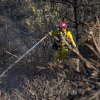 A firefighter puts out hot spots in a wildfire Thursday, July 3, 2014, in the Julian, Calif., area. (AP Photo/UT San Diego, Sean M. Haffey) MANDATORY CREDIT