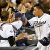 Photo - San Diego Padres' Everth Cabrera is congratulated at the dugout after his run producing double and then scoring against the Colorado Rockies in the fifth inning of a baseball game Monday, April 14, 2014, in San Diego. (AP Photo/Lenny Ignelzi)