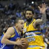 Golden State Warriors guard Stephen Curry, left, tries to drive past Denver Nuggets guard Wilson Chandler, right, in the second quarter of Game 1 in the first round of the NBA basketball playoffs on Saturday, April 20, 2013, in Denver. The Nuggets won 97-95. (AP Photo/Chris Schneider)