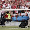 UT\'s Brandon Moore (97) is carted off the field with an injury during the Red River Rivalry college football game between the University of Oklahoma (OU) and the University of Texas (UT) at the Cotton Bowl in Dallas, Saturday, Oct. 13, 2012. Photo by Chris Landsberger, The Oklahoman