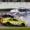 Photo - Matt Kenseth (20) slides backward as he is involved in a crash with Tony Stewart (14), Jeff Gordon (24) and Carl Edwards (99) on the front stretch during the NASCAR Sprint Unlimited auto race at Daytona International Speedway in Daytona Beach, Fla., Saturday, Feb. 15, 2014. (AP Photo/Terry Renna)