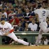 Photo -   New York Yankees' Derek Jeter (2) tries to beat out a grounder as Boston Red Sox first baseman James Loney covers the base during the eighth inning of a baseball game at Fenway Park in Boston Wednesday, Sept. 12, 2012. Jeter left the game after the play. (AP Photo/Elise Amendola)
