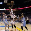 Oklahoma City\'s Kevin Durant (35) goes to the basket between Denver\'s Chris Andersen (11) and Wilson Chandler (21) as Kendrick Perkins (5) watches during the NBA basketball game between the Denver Nuggets and the Oklahoma City Thunder in the first round of the NBA playoffs at the Oklahoma City Arena, Sunday, April 17, 2011. Photo by Bryan Terry, The Oklahoman