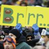 Photo - A fan holds up a sign during the first half of an NFL wild-card playoff football game between the Green Bay Packers and the San Francisco 49ers, Sunday, Jan. 5, 2014, in Green Bay, Wis. (AP Photo/Jeffrey Phelps)