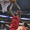Los Angeles Clippers center DeAndre Jordan (6) drives to the hoop as Denver Nuggets\' Danilo Gallinari (8) of Italy and the Clippers\' Blake Griffin look ok during the first half of their NBA basketball game, Tuesday, Dec. 25, 2012, in Los Angeles. (AP Photo/Jason Redmond)
