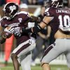 FILE - In this Sept. 22, 2012, file photo, Mississippi State defensive back Johnthan Banks (13) runs past the blocking of teammate linebacker Cameron Lawrence (10) after intercepting a pass in the fourth quarter of an NCAA college football game against South Alabama in Starkville, Miss. The backbone of No. 19 Mississippi State\'s success is a defensive secondary that\'s among the nation\'s most experienced. The starting four have combined for 37 career interceptions, including eight returned for touchdowns. (AP Photo/Rogelio V. Solis, File)
