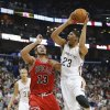 New Orleans Pelicans forward Anthony Davis (23) shoots over Chicago Bulls center Joakim Noah (13) during the first half of an NBA basketball game in New Orleans, Saturday, Feb. 1, 2014. (AP Photo/Bill Haber)