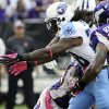 Tennessee Titans running back Chris Johnson, left, fumbles the ball in front of Minnesota Vikings linebacker Erin Henderson (50) during the first half of an NFL football game on Sunday, Oct. 7, 2012, in Minneapolis. (AP Photo/Jim Mone)