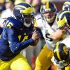 Photo -   Michigan quarterback Denard Robinson (16) rushes in the first quarter of an NCAA college football game against Iowa, Saturday, Nov. 17, 2012, in Ann Arbor, Mich. (AP Photo/Tony Ding)