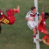 Photo - Ghana's Jonathan Mensah, left, falls  after missing the ball as Germany's Philipp Lahm, centre  and Ghana's Harrison Afful look on during the group G World Cup soccer match between Germany and Ghana at the Arena Castelao in Fortaleza, Brazil, Saturday, June 21, 2014. (AP Photo/Francois Xavier Marit, pool)