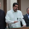 In this photo released by Miraflores Press Office, Venezuela\'s Vice President Nicolas Maduro, center, addresses the nation on live television flanked by Oil Minister Rafael Ramirez, left, and National Assembly President Diosdado Cabello at Miraflores presidential palace in Caracas, Venezuela, Wednesday, Dec. 12, 2012. Maduro said that Chavez will face a