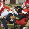 Purcell\'s Tyler Patterson (44) and Erik Gonzalez (8) bring down receiver Tyler Parker (36) after a reception as the Purcell Dragons play the Lexington Lions in high school football on Thursday, September 15, 2011, in Purcell, Okla. Photo by Steve Sisney, The Oklahoman