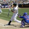 Photo - Oakland Athletics' Seth Smith singles against the Chicago Cubs during the seventh inning of a baseball game Thursday, July 4, 2013 in Oakland, Calif. (AP Photo/Marcio Jose Sanchez)