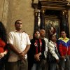 People attend a mass in support of Venezuela\'s President Hugo Chavez at the Havana Cathedral, Cuba, Sunday, March 4, 2012. Chavez revealed Sunday in footage recorded Saturday in Havana that a new tumor recently removed from his pelvic region was of the same type of cancer as a baseball-sized growth extracted from that part of his body about eight months ago. (AP Photo/Javier Galeano)