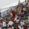 Fans try to catch a foul ball during a Women\'s College World Series game between Oklahoma University and Arizona State University at ASA Hall of Fame Stadium in Oklahoma City, Sunday, June 3, 2012. Photo by Garett Fisbeck, The Oklahoman