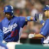 Los Angeles Dodgers\' Matt Kemp is congratulated by Andre Ethier after scorin on a sacrifice fly by Ethier in the eighth inning of an exhibition baseball game against the Los Angeles Angels in Anaheim, Calif., on Thursday, March 28, 2013. (AP Photo/Christine Cotter)