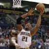 Photo - Indiana Pacers forward David West (21) attempts a basket as he is guarded by Phoenix Suns forward Markieff Morris, left, during the first half of an NBA basketball game, Saturday, March 30, 21013, in Phoenix. (AP Photo/Paul Connors)