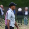 Photo - Tiger Woods of the US carries a basket of golf balls toward the practice chipping green ahead of the British Open Golf championship at the Royal Liverpool golf club, Hoylake, England, Wednesday July 16, 2014. The British Open Golf championship starts Thursday July 17. (AP Photo/Jon Super)