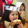 Nizhoni Gould, left, and Guadalupe Munoz represent the Indians and the Pilgrims at the Thanksgiving celebration. Gould is eating bread topped with some of the homemade butter students made. Kindergarten students at Rancho Village Elementary School in southwest Oklahoma City dressed as Pilgrims and Indians and feasted on homemade butter they made in their classrooms earlier in the day. They also ate bread, celery and popcorn which they made in the cafeteria Tuesday afternoon, Nov. 22, 2011. Photo by Jim Beckel, The Oklahoman