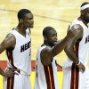 Miami Heat\'s Chris Bosh, left, Dwyane Wade and LeBron James , right, gesture during the second half of Game 2 of the NBA Finals basketball game against the Dallas Mavericks, Thursday, June 2, 2011, in Miami. The Mavericks defeated the Heat 95-93. (AP Photo/Lynne Sladky) ORG XMIT: AAA160