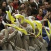 Nuns cheer during Pope Benedict XVI\'s weekly general audience in the Paul VI Hall at the Vatican, Wednesday Feb. 13, 2013. Looking tired but serene, Pope Benedict XVI told thousands of faithful Wednesday that he was stepping down for