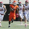 Oklahoma State\'s Joseph Randle (1) runs from Iowa State\'s Jacques Washington (10), David Irving (87) and A.J. Klein (47) on a 62-yard carry in the fourth quarter during a college football game between Oklahoma State University (OSU) and Iowa State University (ISU) at Boone Pickens Stadium in Stillwater, Okla., Saturday, Oct. 20, 2012. OSU won, 31-10. Photo by Nate Billings, The Oklahoman