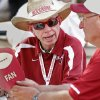Roger Perrin and John Jacobs both of Maysville, talk at a table in front of the Student Union before the college football game between the University of Oklahoma Sooners (OU) and the Tulsa University Hurricanes (TU) at the Gaylord Family-Memorial Stadium on Saturday, Sept. 3, 2011, in Norman, Okla. Photo by Steve Sisney, The Oklahoman