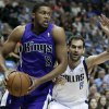Photo - Sacramento Kings' Rudy Gay (8) drives past Dallas Mavericks' Jose Calderon (8) in the first half of an NBA basketball game, Friday, Jan. 31, 2014, in Dallas. (AP Photo/Tony Gutierrez)
