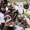 Photo -   Virginia Tech quarterback Logan Thomas (3) is sacked by Florida State linebacker Telvin Smith (22) and defensive end Bjoern Werner (95) during the first half of an NCAA college football game in Blacksburg, Va., Thursday, Nov. 8, 2012. (AP Photo/Steve Helber)
