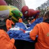 Macy\'s workers unfold a balloon to be inflated for the 86th annual Macy\'s Thanksgiving Day Parade, adjacent to the Chloe and Spider-Man balloons, on New York\'s Upper West Side, Wednesday, Nov. 21, 2012. More than 3 million people typically attend the event and it has a TV audience of 50 million. (AP Photo/Richard Drew)