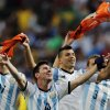 Photo - Argentina's Lionel Messi and teammates celebrate at the end of the World Cup quarterfinal soccer match between Argentina and Belgium at the Estadio Nacional in Brasilia, Brazil, Saturday, July 5, 2014. Argentina won 1-0. (AP Photo/Thanassis Stavrakis)