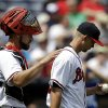 Atlanta Braves catcher Evan Gattis, left, pats starting pitcher Mike Minor on the back as he returns to the mound after giving up a single to Kansas City Royals\' Jeff Francoeur, not pictured, allowing a run to score in the fourth inning of a baseball game, Wednesday, April 17, 2013, in Atlanta. (AP Photo/David Goldman)