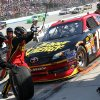 Clint Bowyer\'s crew works on the car during a pit stop in the NASCAR Sprint Cup Series auto race Sunday, Sept. 30, 2012, at Dover International Speedway in Dover, Del. (AP Photo/The News-Journal, Daniel Sato) NO SALES