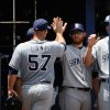 Photo - San Diego Padres' Jason Lane (57) is congratulated by teammates after he leaves his first game as a starting pitcher during the seventh inning of a baseball game against the Atlanta Braves Monday, July 28, 2014, in Atlanta. (AP Photo/David Tulis)