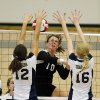 Heritage Hall\'s Lindsey Grace (12) and Rachel Moore (16) block a return by Lincoln Christian\'s Maria Mathews during the Class 5A State Championship volleyball tournament on Friday, Oct. 12, 2012, in Moore, Okla. Photo by Steve Sisney, The Oklahoman