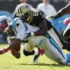 Photo -   In this Oct. 9, 2011, photo, Carolina Panthers' Cam Newton, left, is tackled by New Orleans Saints' Jonathan Vilma (51) during an NFL football game in Charlotte, N.C. The suspensions of Vilma and three other players in the NFL's bounty investigation were lifted Friday, Sept. 7, 2012, by a three-member appeals panel and the league reinstated those players a few minutes later. The ruling does not permanently void their suspensions. (AP Photo/Bob Leverone)