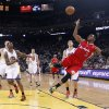 Los Angeles Clippers\' Chris Paul (3) scores on an off-balance shot past Golden State Warriors\' Harrison Barnes (40) and Klay Thompson, behind Paul, during the first half of an NBA basketball game in Oakland, Calif., Monday, Jan. 21, 2013. (AP Photo/Marcio Jose Sanchez)