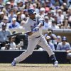 Photo - Los Angeles Dodgers' Juan Uribe drives in the first run of a baseball game against the San Diego Padres in the seventh inning in San Diego, Sunday, June 23, 2013. (AP Photo/Lenny Ignelzi)