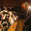 Photographers take photos of Olympic athlete Oscar Pistorius as he stands in the dock during his bail hearing at the magistrates court in Pretoria, South Africa, Friday, Feb. 22, 2013. The fourth and likely final day of Oscar Pistorius\' bail hearing opened on Friday, with the magistrate then to rule if the double-amputee athlete can be freed before trial or if he has to remain in custody over the shooting death of his girlfriend. (AP Photo/Themba Hadebe)