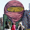 People walk past a mural painted on the side of a building in Boston, Wednesday, Jan. 23, 2013. The National Weather Service says it\'s not expected to get above 17 degrees in Boston, with the wind chill making it feel five below. (AP Photo/Michael Dwyer)