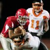 Carl Albert\'s Dillan Dansby is brought down by William Whayne of Booker T. Washington during a high school football game in Midwest City, Okla., Friday, September 3, 2010. Photo by Bryan Terry, The Oklahoman